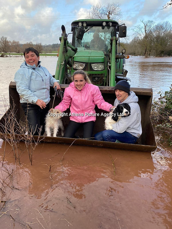 "Pictured: The Price family who were rescued in a bucket of a tractor.<br /> Re: A family in rural Monmouthshire was saved by a local farmer and his tractor on Sunday, after five feet of floodwater poured into their home, stranding them.<br /> Amy Price said she, her parents, and their two dogs were all trapped in the house for nine hours when Storm Dennis caused the River Usk to burst its banks next to their Llanover home.<br /> ""This is the worst it has ever flooded,"" she said. ""The noise it was making was horrendous – it was so scary.""<br /> Flood alerts had been put out for the area on Saturday, but nothing could have prepared the family for the extent of that night's rainfall and flooding."