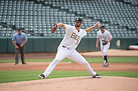 Scott Snodgress (36) of the Salt Lake Bees in action against the Tacoma Rainiers in Pacific Coast League action at Smith's Ballpark on May 7, 2015 in Salt Lake City, Utah. The Bees defeated the Rainiers 11-4 in the completion of the game that was suspended due to weather on May 6, 2015.(Stephen Smith/Four Seam Images)