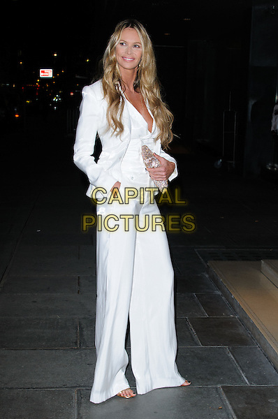 Elle MacPherson.The Rodial Beautiful Awards 2012, held at the Sanderson - Arrivals .London, England..March 6th, 2012.full length white suit blazer jacket trousers flared wide leg silver clutch bag .CAP/CJ.©Chris Joseph/Capital Pictures.