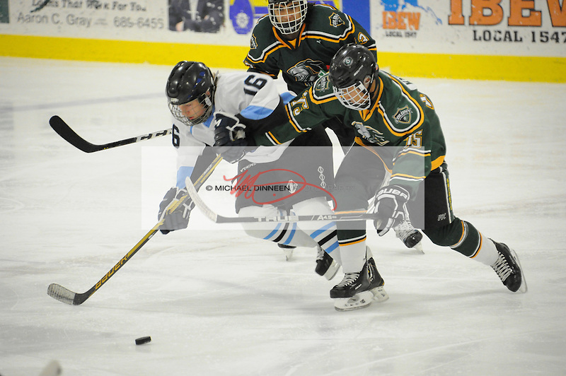 Chugiak's Peter Symmes is sandwiched by Colony's Tristan Avoletta during the Mustangs' 3-2 win at the McDonald Center in Eagle River Tuesday night. Photo for the Star by Michael Dinneen