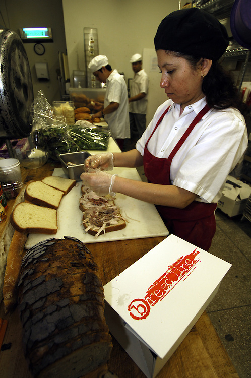 Kitchen staff prepares box lunches at the Bread Line restaurant in Washington, D.C.