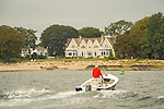 Long Island Sound Shoreline. Guilford Harbor with mansion and motor boater.
