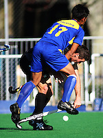 Malaysia's Muhammad Razie Abd. Rahim collides with Joel Baker during the international hockey match between the New Zealand Black Sticks and Malaysia at Fitzherbert Park, Palmerston North, New Zealand on Sunday, 9 August 2009. Photo: Dave Lintott / lintottphoto.co.nz