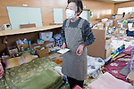 An elderly resident left homeless by the March 11 quake and tsunami asks a postal services official to post a letter for her at the KadonowakiJunior HighSchool in Ishinomaki, Miyagi Prefecture, Japan on Tuesday 24 May 2011..Photographer: Robert Gilhooly