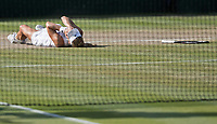 Angelique Kerber (GER) lays on centre court In tears after winning the Wimbledon Ladies Singles Final, beating Serena Williams (USA) in straight sets 6-3 6-3