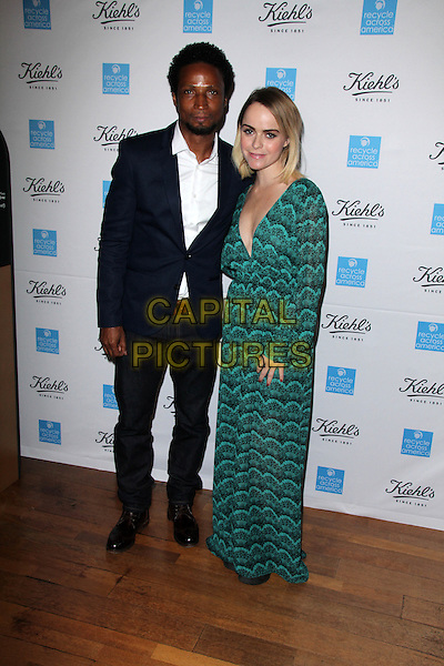 Elvis Nolasco, Taryn Manning at the Kiehl's 2015 Earth Day Project With Elizabeth Olsen And Maggie Q at Kiehls Since 1851 Santa Monica Store on April 15, 2015 in Santa Monica, California. <br /> CAP/MPI/DC/DE<br /> &copy;DE/DC/MPI/Capital Pictures