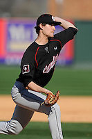 Starting pitcher Jack Wynkoop (13) of the South Carolina Gamecocks delivers in the Reedy River Rivalry game against the Clemson Tigers on March 1, 2014, at Fluor Field at the West End. South Carolina won, 10-2 and Wynkoop got the win. (Tom Priddy/Four Seam Images)