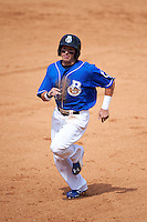 Biloxi Shuckers outfielder Kyle Wren (11) running the bases during a game against the Birmingham Barons on May 24, 2015 at Joe Davis Stadium in Huntsville, Alabama.  Birmingham defeated Biloxi 6-4 as the Shuckers are playing all games on the road, or neutral sites like their former home in Huntsville, until the teams new stadium is completed in early June.  (Mike Janes/Four Seam Images)