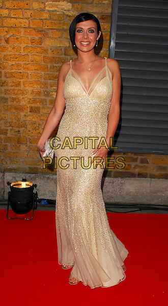 KYM MARSH.OK! Magazine - private 10th anniversary party, Old Billingsgate, London, UK..May 10th, 2006.Ref: CAN.full length beige sequins.www.capitalpictures.com.sales@capitalpictures.com.©Capital Pictures