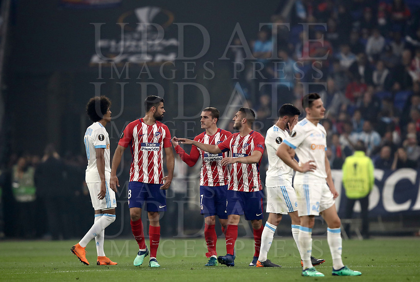 Club Atletico de Madrid's Antoine Griezmann, third from left,  celebrates with his teammates after scoring his first goal during the UEFA Europa League final football match between Olympique de Marseille and Club Atletico de Madrid at the Groupama Stadium in Decines-Charpieu, near Lyon, France, May 16, 2018.<br /> UPDATE IMAGES PRESS/Isabella Bonotto