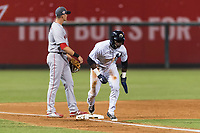 AFL West outfielder Estevan Florial (13), of the Glendale Desert Dogs and New York Yankees organization, runs home after tagging up in front of Bobby Dalbec (11) during the Arizona Fall League Fall Stars game at Surprise Stadium on November 3, 2018 in Surprise, Arizona. The AFL West defeated the AFL East 7-6 . (Zachary Lucy/Four Seam Images)