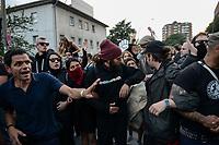 """GERMANY, Hamburg, protest rally """"G-20 WELCOME TO HELL"""" against G-20 summit in july 2017, black block with mummed people /DEUTSCHLAND, Hamburg, Landungsbruecken, Protest Demo WELCOME TO HELL gegen G20 Gipfel , vermummte Demonstranten des schwarzen Block, vorne links im blauen Polo Shirt Andreas Blechschmidt, Sprecher des linksalternativen Zentrums """"Rote Flora"""""""