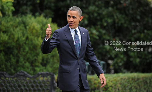United States President Barack gives a thumbs up as he walks to Marine One on the South Lawn to depart the White House October 7, 2012 in Washington, DC. Obama is heading to a campaign event in Los Angeles, California..Credit: Olivier Douliery / Pool via CNP