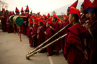 Buddhist monk playing musical instruments during the Losar chanting in a monastery in Sikkim India