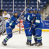 Parker Bowen (Salve Regina - 16), Jonathan Felteau (Salve Regina - 11), Justin Jones (Salve Regina - 17) and Lucas Sousa (Salve Regina - 2) celebrate Bowen's goal. - The Wentworth Institute of Technology Leopards defeated the Salve Regina University Seahawks 2-1 on Tuesday, November 12, 2013, at Tsongas Arena in Lowell, Massachusetts.
