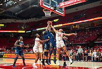 COLLEGE PARK, MD - NOVEMBER 20: Kayla Mokwuah #24 and Neila Luma #30 of George Washington defend against Stephanie Jones #24 of Maryland during a game between George Washington University and University of Maryland at Xfinity Center on November 20, 2019 in College Park, Maryland.