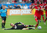 11 September 2010: D.C. United midfielder Kurt Morsink #6 and Toronto FC midfielder Martin Saric #25 in action during a game between DC United and Toronto FC at BMO Field in Toronto..DC United won 1-0..