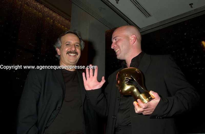 Sept 2, 2002, Montreal, Quebec, Canada<br /> <br /> Jury President Majid Majidi (L) talk with  film maker  Diego Arsuaga (R)<br />   best screen play award for his movie EL ULTIMO TREN,at the closing ceremony of the 2002 Montreal World Films Festival, Sept 2 2002, in  Montreal, Quebec, Canada<br /> <br /> <br /> Mandatory Credit: Photo by Pierre Roussel- Images Distribution. (&copy;) Copyright 2002 by Pierre Roussel <br /> <br /> NOTE : <br />  Nikon D-1 jpeg opened with Qimage icc profile, saved in Adobe 1998 RGB<br /> .Uncompressed  Uncropped  Original  size  file availble on request.