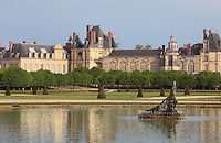 The Grand Parterre, the largest formal garden in Europe, created 1660-64 by Andre Le Notre and Louis Le Vau for King Louis XIV, with the Chateau de Fontainebleau behind, France. The Palace of Fontainebleau is one of the largest French royal palaces and was begun in the early 16th century for Francois I. It was listed as a UNESCO World Heritage Site in 1981. Picture by Manuel Cohen