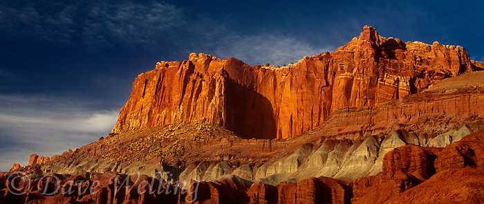 908000007 panoramic  sunset light turns the sandstone formations of the waterpocket foldl red and gold in capitol reef national park in utah