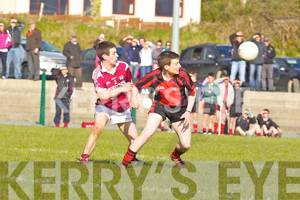Scartaglen's Ger Connor and Connie Murphy of GlenbeighGlencar eye up the loose ball  last Saturday afternoon in Scartaglen.