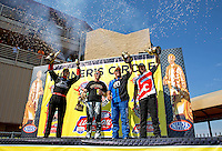 Jul. 21, 2013; Morrison, CO, USA: NHRA pro champion drivers (L-R) top fuel Spencer Massey , pro stock motorcycle Shawn Gann , pro stock Allen Johnson and funny car Cruz Pedregon celebrate in the winner's circle after winning the Mile High Nationals at Bandimere Speedway. Mandatory Credit: Mark J. Rebilas-