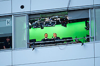 The real Brent Musberger and Kirk Herbstreit watch from the broadcast booth.