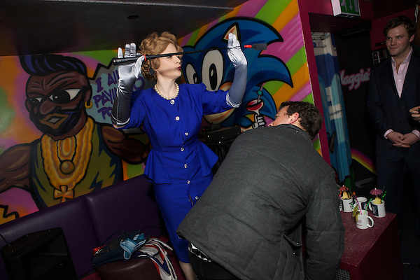 Margaret Thatcher impersonator Honey Wilde whips a guest before performing a strip tease at Maggies Nightclub in Chelsea