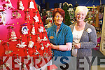 Marian Lynch and Maria Lyons with the range of Newbridge silverware christmas decorations  at McKennas of Listowel.