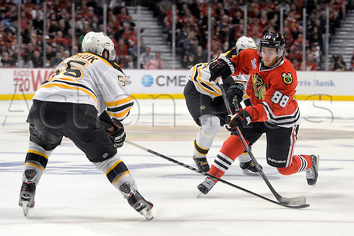 12.06.2013 Chicago, USA.  Chicago Blackhawks right wing Patrick Kane (88) battles with Boston Bruins defenseman Johnny Boychuk (55) in action during game one of the Stanley Cup Finals between the Boston Bruins and the Chicago Blackhawks, at the United Center.