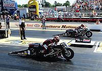 May 4, 2012; Commerce, GA, USA: NHRA pro stock motorcycle rider Andrew Hines (near lane) races alongside teammate Eddie Krawiec during qualifying for the Southern Nationals at Atlanta Dragway. Mandatory Credit: Mark J. Rebilas-