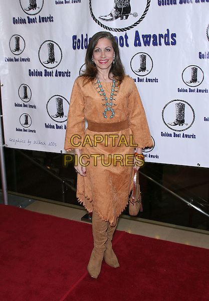 VICKI ROBERTS.The Motion Picture and Television Fund's 24th Golden Boot Awards - Arrivals at the Beverly Hilton Hotel, Beverly Hills, California, USA, 12 August 2006..full length brown tunic dress boots red indian costume.Ref: ADM/ZL.www.capitalpictures.com.sales@capitalpictures.com.©Zach Lipp/AdMedia/Capital Pictures.