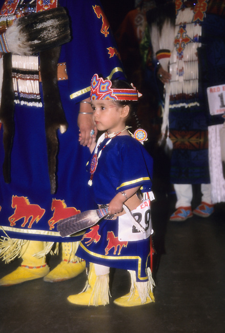 Young tiny tot dance participant dressed in traditional clothing during the Red Earth Indian Pow Wow and Festival, Oklahoma City OK