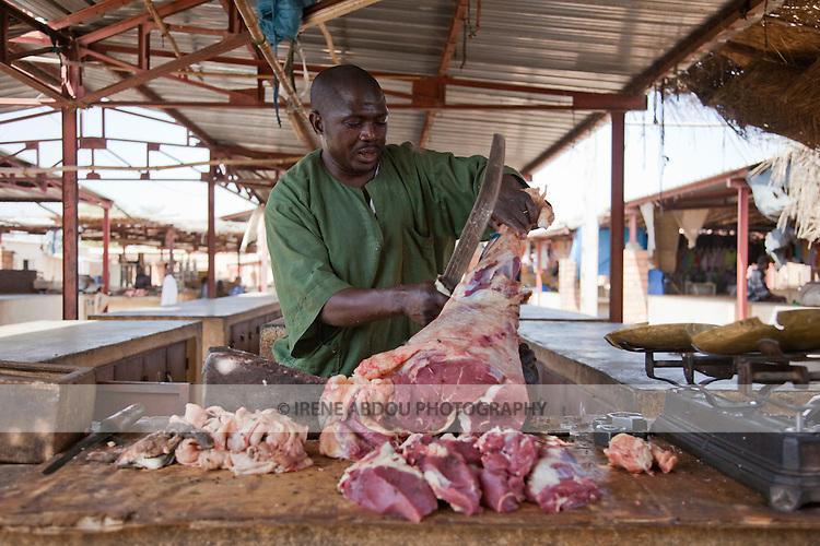 A butcher cuts meat in the market in Segou, Mali.