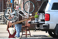 Mike Javicky ((cq)) of Eureka Springs loads a table made out of a bicycle Sunday May 17, 2020 in downtown Prairie Grove. Javicky found and bought the table at Daisies & Olivies Antiques and Flea Market, where he also has a booth of items for sale. He plans to use the bike-table at his home. Visit nwaonline.com/200517Daily/ for daily image galleries. (NWA Democrat-Gazette/J.T. Wampler)