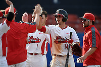 Illinois State Redbirds Paul DeJong (14) greeted by teammates after hitting a home run during a game against the Bowling Green Falcons on March 11, 2015 at Chain of Lakes Stadium in Winter Haven, Florida.  Illinois State defeated Bowling Green 8-7.  (Mike Janes/Four Seam Images)