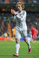Luka Modric salutes fans in a corner kick