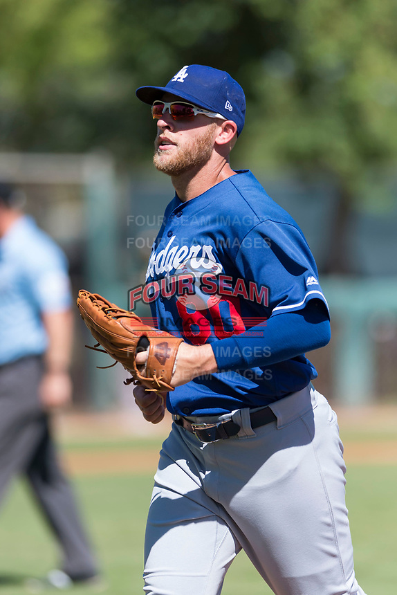 Los Angeles Dodgers left fielder Matt Beaty (80) jogs off the field between innings of an Instructional League game against the Oakland Athletics at Camelback Ranch on September 27, 2018 in Glendale, Arizona. (Zachary Lucy/Four Seam Images)