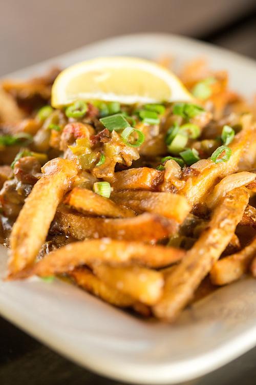 Hillsborough, North Carolina - Thursday January 21, 2016 - LaPlace's étouffée fries. House fries smotherd in crawfish étouffée.