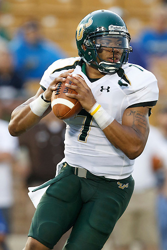 South Florida quarterback B.J. Daniels (#7) sets to pass the ball in action during NCAA football game between Notre Dame and South Florida.  The South Florida Bulls defeated the Notre Dame Fighting Irish 23-20 in game at Notre Dame Stadium in South Bend, Indiana.
