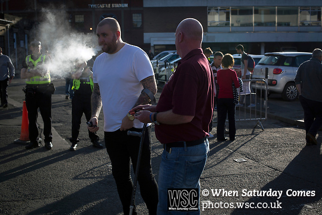 Heart of Midlothian 1 Birkirkara 2, 21/07/2016. Tynecastle Park, UEFA Europa League 2nd qualifying round. Two fans, one smoking a 'vape', pictured outside Tynecastle Park, Edinburgh as fans arrive before Heart of Midlothian played Birkirkara of Malta in a UEFA Europa League 2nd qualifying round, second leg. The match ended in victory for the Maltese side by 2-1 and they progressed on aggregate after the first match had ended 0-0. The game was watched by 14301 spectators, including 56 visiting fans of Birkirkara. Photo by Colin McPherson.