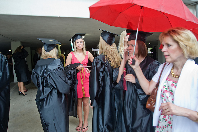 Ohio University graduates wait in the rain for the commencement ceremony to begin  on Saturday, June 12, 2010 at Ohio University's Convocation Center.