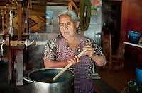 Rug weaver Gloria Santiago (cq) mixes dye at Casa Santiago in Teotitlán del Valle, Oaxaca, in Mexico, Tuesday, April 10, 2012. ..Photo by Matt Nager