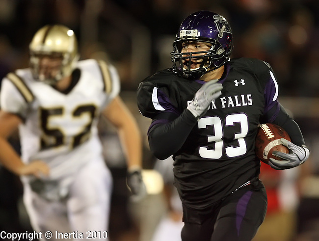 SIOUX FALLS, SD - OCTOBER 2: Alex Morales #33 of University of Sioux Falls returns an interception past Ryan Beebe #52 from Nebraska Wesleyan in the third quarter of their game Saturday night at the University of Sioux Falls Sports Complex. (photo by Dave Eggen/Inertia)