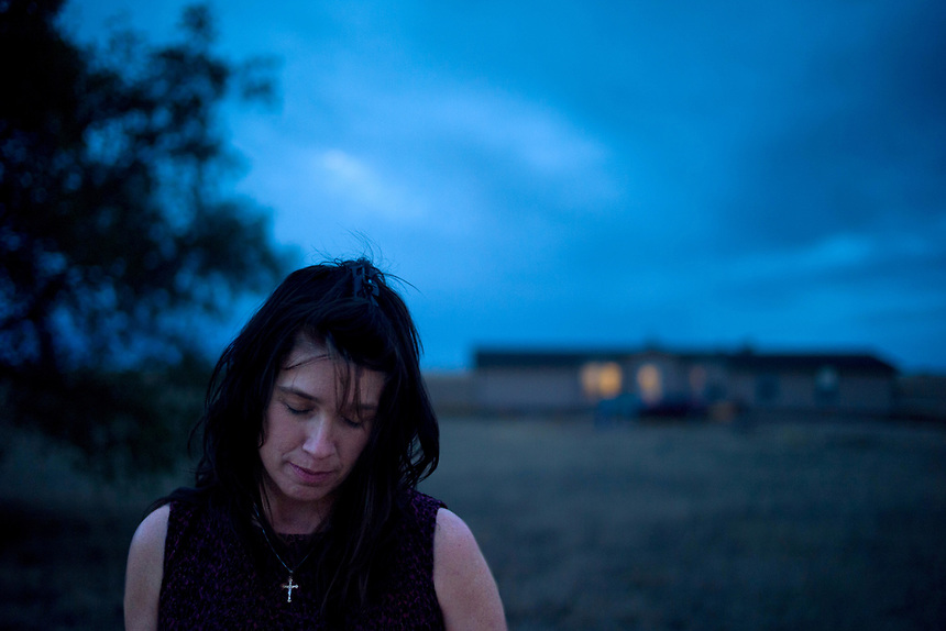 "Sonya Robison, of rural Yoder, Colo., was attacked in 2006 at home and missed a couple of payments while deciding whether to abandon the home because of her trauma. She decided to stay, and negotiated a repayment plan with her servicer. Though Robison was current on payments, she went away for Christmas and returned to find the locks changed and the house ""winterized."" The electricity, gas, water supply were all turned off. The servicer said it was a mistake, they would cover the costs of turning everything back on. She suggested she just skip on payment. By the time she made the next payment, they sent it back and initiated foreclosure proceedings. But it turns out the party that's filed the foreclosure does not appear on any deed or note. She is suing the bank. (Photo/Kevin Moloney for the New York Times)"