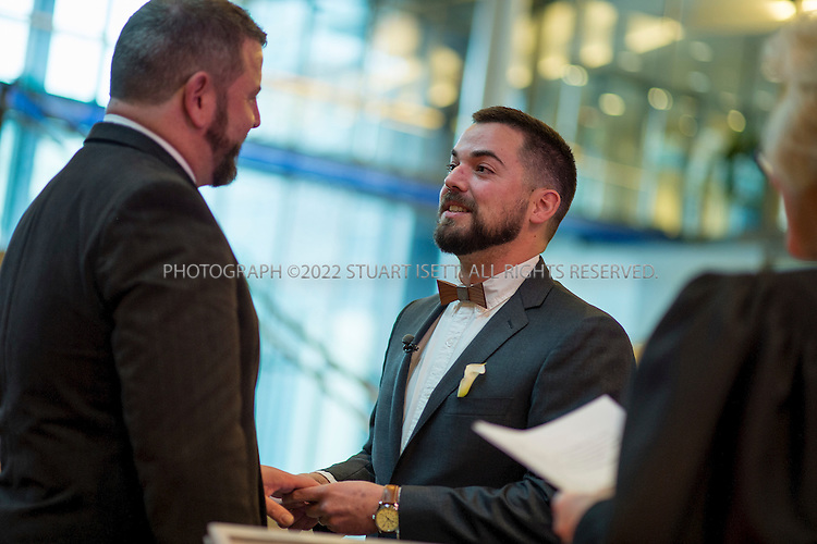 12/9/2012--Seattle, WA, USA...Corianton Hale, 34, right, and Keith Bacon, 44 left, of Seattle get married by Judge Karli Jorgensen at City Hall...On the first day same sex couples were allowed to marry in Washington State, Hundreds of well-wishers braved cold and rain to celebrate 133 weddings at Seattle City Hall. Washington, Maine and Maryland last month became the first U.S. states to extend marriage rights to same-sex couples by a popular vote, in a leap forward for gay rights. A crowd of several hundred people waited outside City Hall in the cold to cheer couples as they descended the steps, some throwing bird seed, rice, blowing bubbles and handing flowers to the newlyweds...©Stuart Isett. All rights reserved.