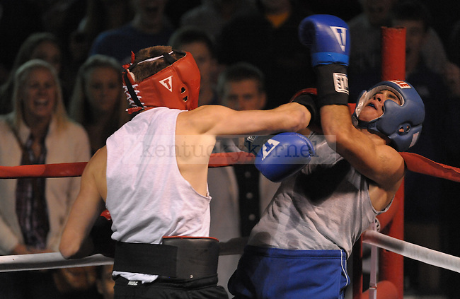 Benton Hupman (left) from Phi Delta Theta fights Josiah Hanna (right) from Triangle at the Sigma Chi Fraternity & Alpha Delta Pi Sorority sponsored The Main Event 2011 in Lexington, Ky. Benton Hupman won the fight. Photo by Mike Weaver |