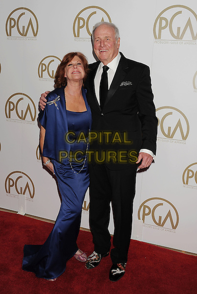 BEVERLY HILLS, CA- JANUARY 19: Producer Jerry Weintraub (R) and wife Jane Morgan arrive at the 25th Annual Producers Guild Awards at The Beverly Hilton Hotel on January 19, 2014 in Beverly Hills, California.<br /> CAP/ROT/TM<br /> &copy;Tony Michaels/Roth Stock/Capital Pictures
