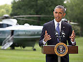"""United States President Barack Obama makes a statement on the situation in Iraq prior to departing the South Lawn of the White House for a trip to North Dakota on Friday, June 13, 2014.  In his remarks the President said """"We will not be sending US troops back into combat in Iraq,"""" but said he has asked his national security team for a """"range of options that he will be reviewing in the days ahead.""""<br /> Credit: Martin Simon / Pool via CNP"""