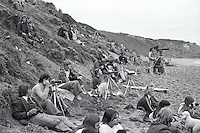 Spectators and photographers on the cliffs and on the beach  during the  running of the 1976 Rip Curl Pro, Bells Beach, Torquay, Victoria, Australia. Easter 1976. .Photo:  joiliphotos.com